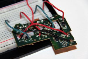 The circuit board with new leads, connected to a breadboard.