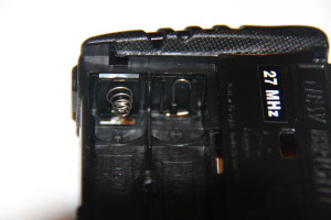 The existing battery leads in the remote. The spring for the negative lead needs to be compressed to pull out the circuit board.